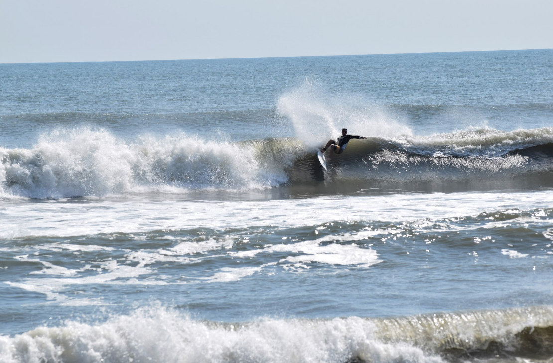 Surfing on the 4x4 beach in July