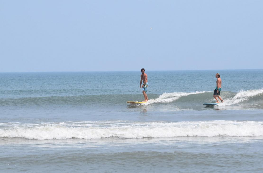 surfers on the 4x4 beach