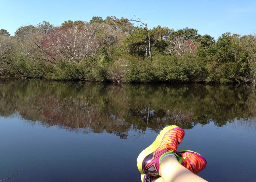 running shoes and reflection in Corolla