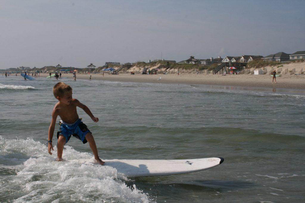 boy surfing corolla