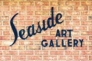 seaside art gallery sign