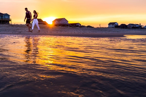 Couple beach walk